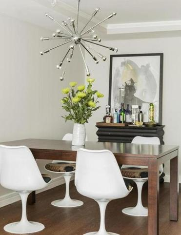 A Sputnik pendant and Tulip chairs in the dining area.