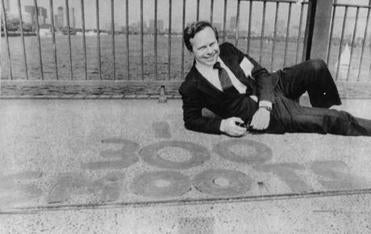 Olver R. Smoot Jr. came back to the Harvard Bridge for his 25-year college reunion in 1987 and posed at the 300-smoot mark on the span, which crosses the Charles River.