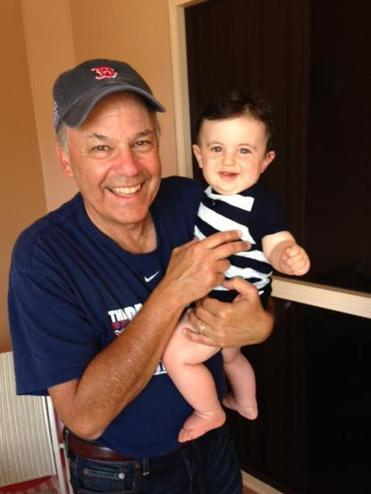 The meteorologist holding his youngest grandchild, Henry.
