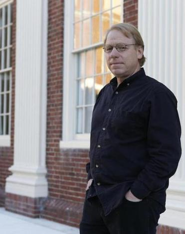 Composer Michael Pisaro  in front of the Harvard Music Building.