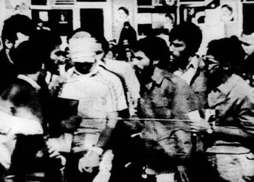 "A blindfolded hostage was paraded by his captors in the US Embassy Compound on Nov. 8, 1979, as an Iranian crowd of thousands reportedly chanted, ""death to Carter — Yankee go home."""