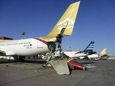 Damaged aircraft is seen at Tripoli International Airport after unidentified war planes attacked targets in the Libyan capital in August.