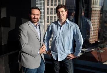 Boston, MA -- 12/12/14 -- LeanBox co-owners Shea Coakley(left) and Peter Roy(right), pose for a portrait in the Baystate Financial Services cafeteria on December 12, 2014, in Boston, Massachusetts. (Photo by Kayana Szymczak for the Boston Globe)