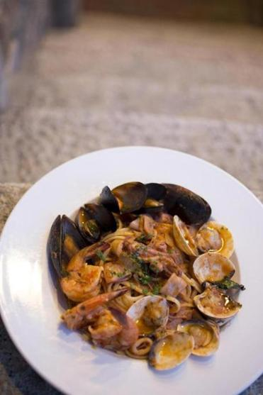 Linguine ai frutti di mare, with mussels, clams, calamari, and shrimp, is a signature dish at Trattoria Bar 89 Centrale.