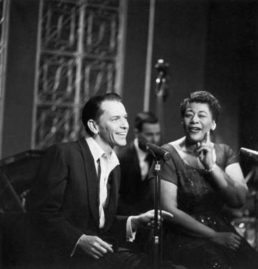 Frank Sinatra and Ella Fitzgerald performing on a TV special circa 1955.