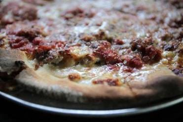 East Boston, MA - 01/20/15 - Homemade sausage and garlic pizza at Santarpio's in East Boston. Lane Turner/Globe Staff Section: MAG Reporter: francis storrs Slug: 020815BestPizza
