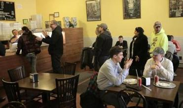 Boston, MA - 01/22/15 - Customers line up at Galleria Umberto on Hanover Street in the North End. Lane Turner/Globe Staff Section: MAG Reporter: francis storrs Slug: 020815BestPizza