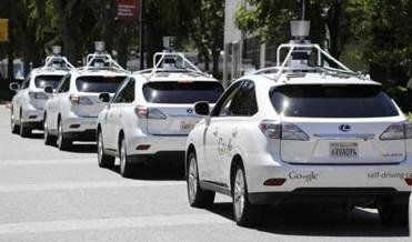 "FILE - This file photo taken Tuesday, May 13, 2014 shows a row of Google self-driving cars outside the Computer History Museum in Mountain View, Calif. California's Department of Motor Vehicles will miss a year-end deadline to adopt new rules for cars of the future because regulators first have to figure out how they'll know whether ""driverless"" vehicles are safe. (AP Photo/,File)"