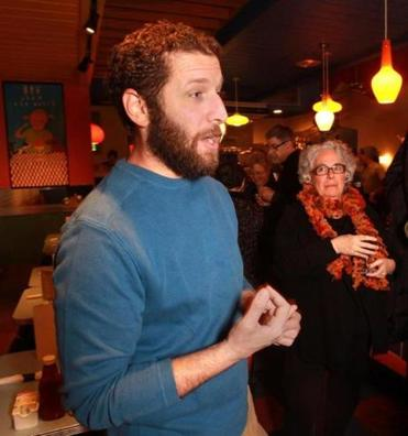 01-28-2015: Newton, MA: Jared Auerbach of Red's Best sustainable seafood talks with guest at Johnny's Luncheonette during seafood dinner in Newton, Mass. January 28, 2015. Photo/John Blanding, Boston Globe staff story/Lisa Zwirm ( 11redsbest )