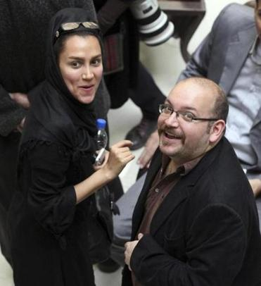 Jason Rezaian, a correspondent for The Washington Post, and his wife Yeganeh Salehi, an Iranian correspondent for the Abu Dhabi-based daily newspaper, The National, smiled as they attended a presidential campaign event for President Hassan Rouhani in Tehran in 2013. Rezaian was detained in Tehran on July 22 along with Salehi and two photojournalists.
