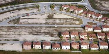 "Empty lots sat next to newly constructed homes in a Homestead, Fla., subdivision in 2009. In 2011, the US Financial Crisis Inquiry Commission report pointed to the housing bubble and ""widespread failures in financial regulation"" as the cause of the nationwide fiscal crisis."