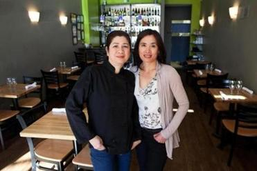 Brookline, MA -- 03/19/15 -- Head Chef Kannarisa Phohirun (left) and Owner and Executive Chef Pon Hunter (right) pose for a portrait at Pon Thai Bistro on March 19, 2015, in Brookline, Massachusetts. (Kayana Szymczak for the Boston Globe) (Note to editor: Yotin, the front of house manager, was in Thailand, so I was unable to take a portrait of him.)