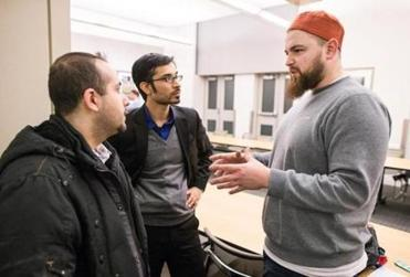 From left, Anas Al Bastami and Yusufi Vali speak with AbdelRahman Murphy at MIT.