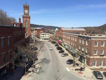 "This is the overhead shot of the ""Square,"" the heart of downtown Bellows Falls around which most of the featured locations are situated. The Rockingham Town Hall is at left with the clock tower. (Rockingham is the town in which the village of Bellows Falls exists, fyi.) Photo credit: Mark Kenney (fyi, he is co-owner of The Flat Iron Exchange)"
