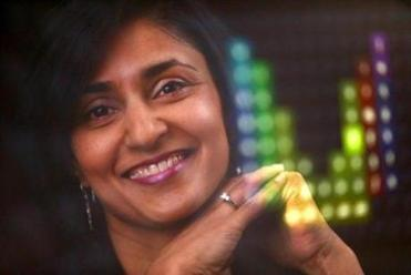 Belmont, MA - 04/27/15 - Rupal Patel, Founder of VOCALiD and a professor at Northeastern University, reflected in her computer screen showing the voice recording visual used to bank donor voices. Lane Turner/Globe Staff Section: MAG Reporter: katie johnston-chase Slug: 10gamechangers-vocalid