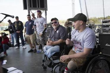 Honoree veternans Aaron Alonso (far right) and Mike Downing (second to right) share their stories. Boston's Wounded Vet Run. Kieran Kesner for The Boston Globe.