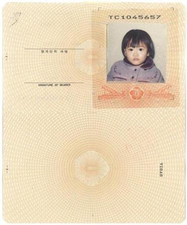 A passport photo of a South Korean adoptee.