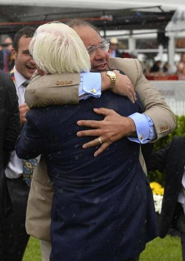 Ahmed Zayat embraces trainer Bob Baffert after American Pharoah won the Preakness.