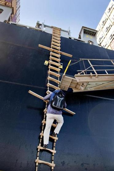 Scott MacNeil steadies himself as he climbs onto the MSC Lorena.