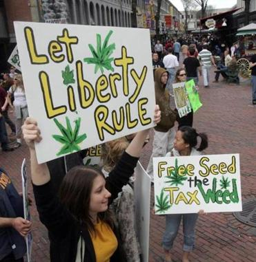 Members of the National Organization for Reform of Marijuana Laws held signs outside Quincy Market in 2007.