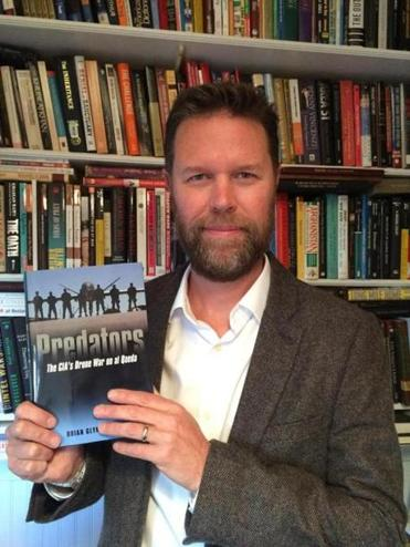 "UMass Dartmouth professor Brian Glyn Williams with his book ""Predators: The CIA's Drone War on Al Qaeda."""