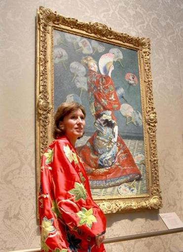 "Sue Danielson of Kentucky, with Monet's ""La Japonaise"" at the Museum of Fine Arts on June 24. The museum had kimonos for people to try on and pose as Camille Monet did in the painting."
