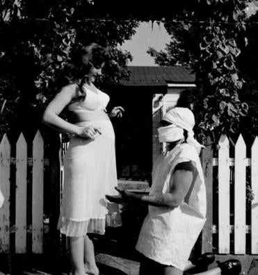 Bruce, in a makeshift doctor's costume, with his pregnant wife, Honey Harlow, in 1955, the year their child, Kitty, was born.