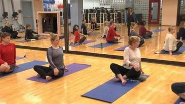 Aetna employees participated in a yoga class at the company's Hartford, Conn. headquarters.