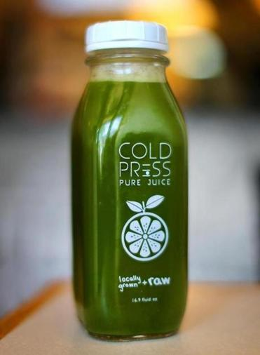A juice from the cooler at Pure Cold Press.