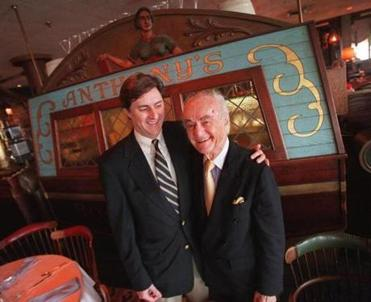 Anthony Athanas (right), the late founder of Anthony's Pier 4 restaurant, celebrated his 89th birthday in 2000 with his son Michael.