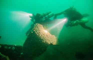 Divers examined the stern of the ship, which sank in July 1956 after colliding with the MS Stockholm.