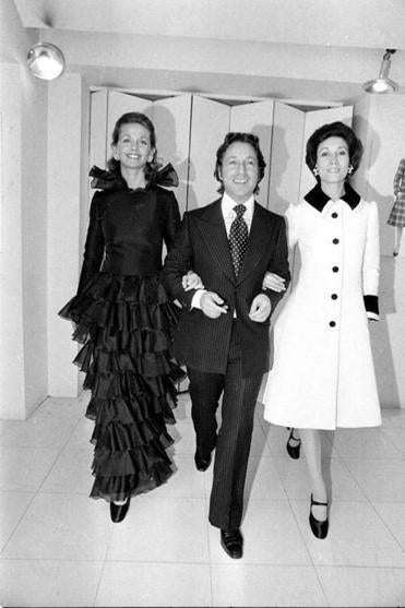 Designer Arnold Scaasi walked with two models at his studio in Paris in 1972.