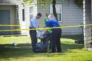 Officers searched for evidence at the Auburn home on Sunday.