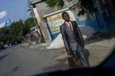 A boy made his way to school exams in Les Cayes, Haiti.