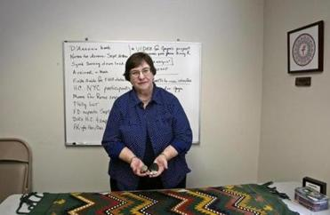"Donna Doucette, executive director of VOTF, holds objects used as ""talking pieces"" in healing circles."