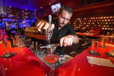 Osteria Nino's head bartender, Casey Furtaw, poured a drink.