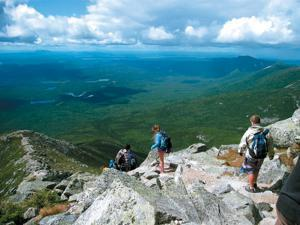 This Aug. 27, 2014 photo shows hikers making their way down Mount Katahdin in Baxter State Park in Maine. The mountain is nearly a mile high and is the tallest mountain in Maine. Its peak is the northern terminus of the Appalachian Trail. (AP Photo/Beth J. Harpaz)