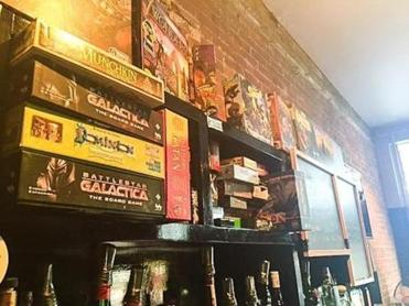 Board games among the vintage stock at Arcadia National Bar in Portland, Maine.