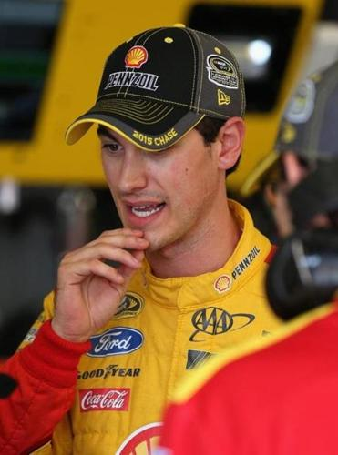 JOLIET, IL - SEPTEMBER 19: Joey Logano, driver of the #22 Shell Pennzoil Ford, stands in the garage area during practice for the NASCAR Sprint Cup Series MyAFibRisk.com 400 at Chicagoland Speedway on September 19, 2015 in Joliet, Illinois. (Photo by Jonathan Daniel/Getty Images)
