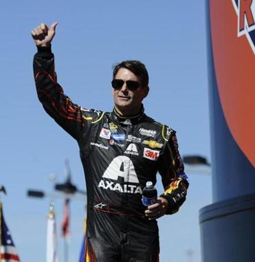 FILE - In this Sunday, Sept. 20, 2015, file photo, Jeff Gordon greets fans during drivers introduction for the NASCAR Sprint Cup Series auto race at Chicagoland Speedway in Joliet, Ill. Gordon will set the record for most consecutive starts on Sunday when he takes the green for his 789th-straight Cup race. (AP Photo/Matt Marton, File)