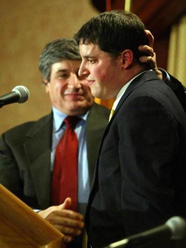 Thomas Fulchino, left, comforts his son, Christopher. Both allegedly were molested by Boston priests.