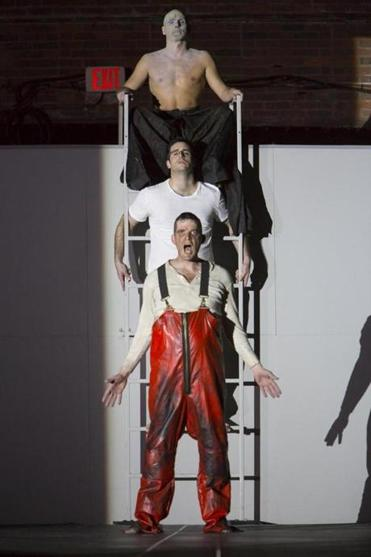 "From top: Yury Yanowsky, Neal Ferreira, and David McFerrin in Boston Lyric Opera's production of ""In the Penal Colony."""