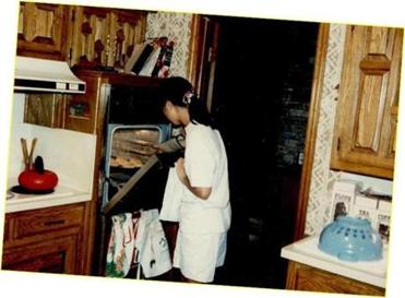 A teenage Chang baking cookies at home in Dallas around 1986.