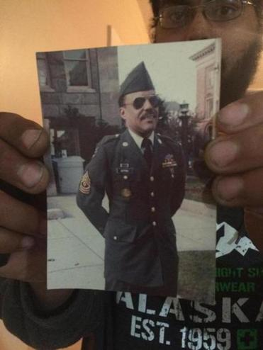 Barry Depina held a photo of his father Donald Depina.