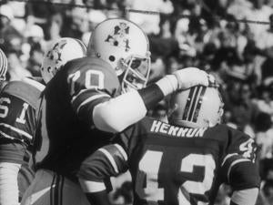 At 5 feet 5 inches, Herron was dwarfed by teammates such as offensive lineman Leon Gray.