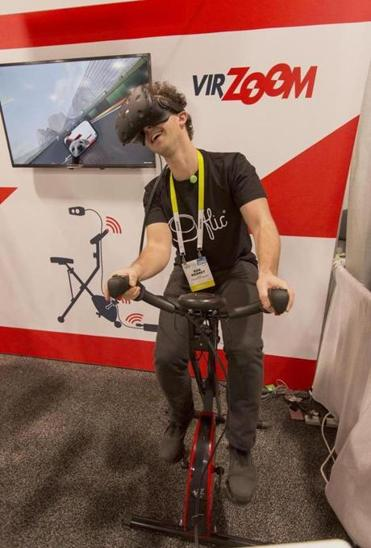 Rob Merret of Stockholm, Sweden pedaled though a virtual reality world.