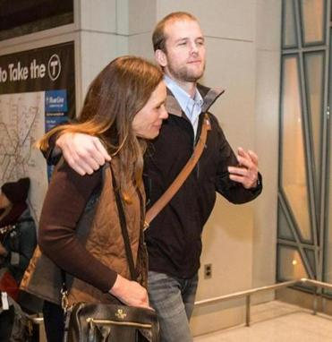 Matthew Trevithick left Logan International Airport Sunday evening with his mother, Amelia Newcomb, after being freed from an Iranian prison.