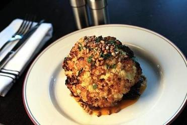 Rotisserie cauliflower served on mushrooms.