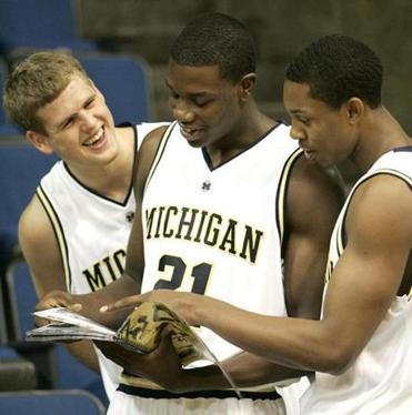 Price (center) with University of Michigan teammates Zack Gibson (left) and Jevohn Shepherd in 2006.