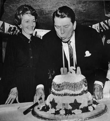 Hooksett, N.H. 2/5/1980- GOP presidential hopeful Ronald Reagan blows out candles on his birthday cake as his wife Nancy looks on during a birthday party held to celebrate his 69th birthday (2/5). Reagan turned 69 on Feb 6th. Photo by John Tlumacki(national)